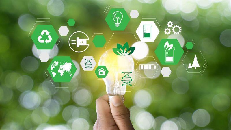 Die Fotomontage zeigt Symbole aus den Bereichen Umwelt und Energiesystem.